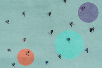 Aerial view of people walking on a green surface