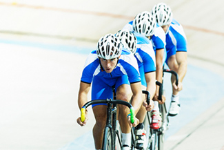 Cycling team pursuit on a track velodrome