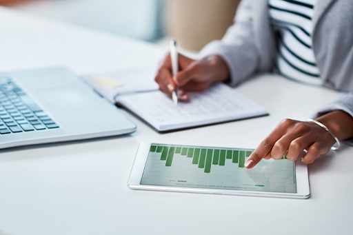 Businesswoman looking at financial reports on a digital tablet