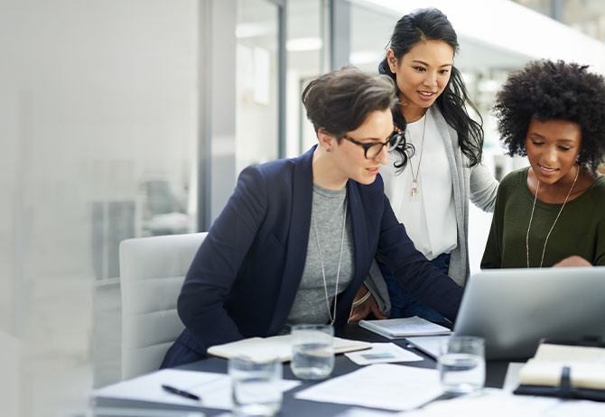 Businesswomen using a laptop during a meeting at work
