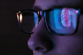 Cyber security reflection of digital fingerprint in eyeglasses