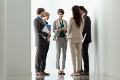 Group of business people meeting in a hallway