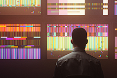 Man watching tv's with psychedelic screens