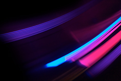Neon colour streaks on black background