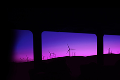 Renewable energy windmills in purple sunset