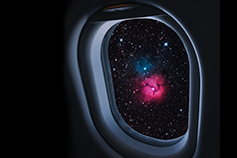 Tourist plane window looking out into space