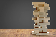Wooden blocks stacked strategically