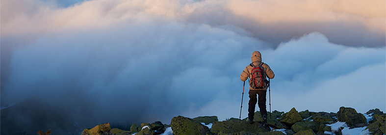 Hiker looking over clouds