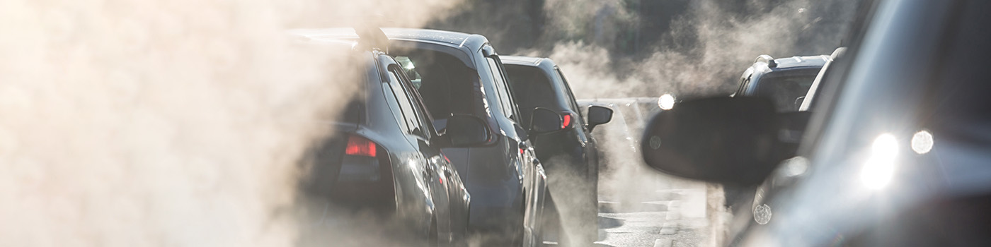 Traffic jam of cars surrounded by steam from the exhaust