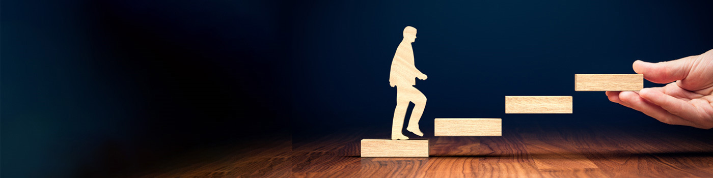 wooden figure going up stairs