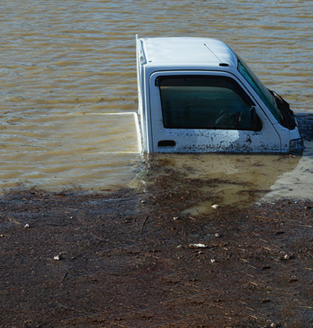 Pick-up truck under water on flooded road