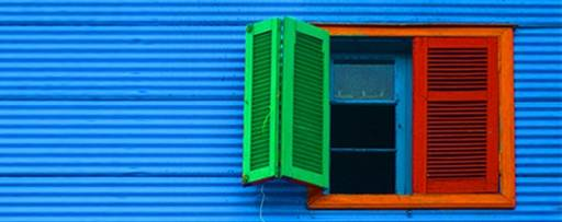 Red window on blue wall