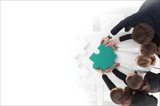 Business people putting puzzle piece together