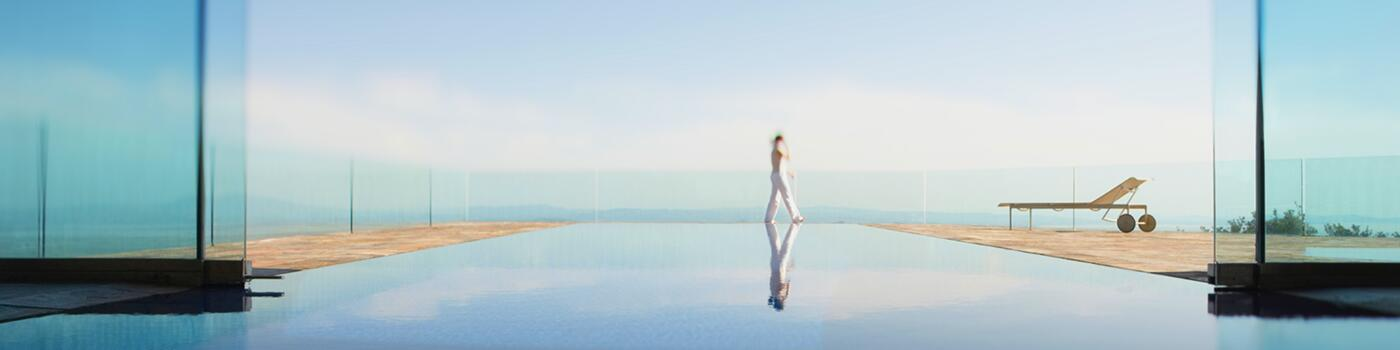 Woman walking by a pool