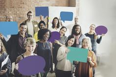 Group of people holding speech bubble cutouts