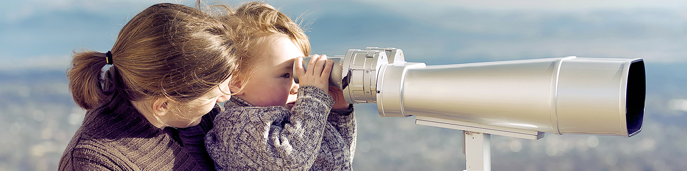 mother daughter using telescope
