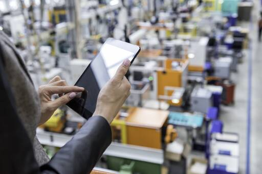 Woman using tablet in warehouse
