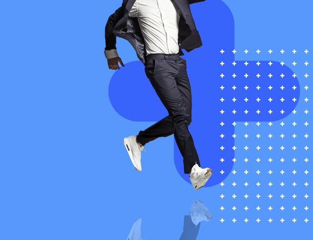 Man in suit with running shoes