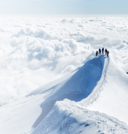 Mountain climbers on snowy peak