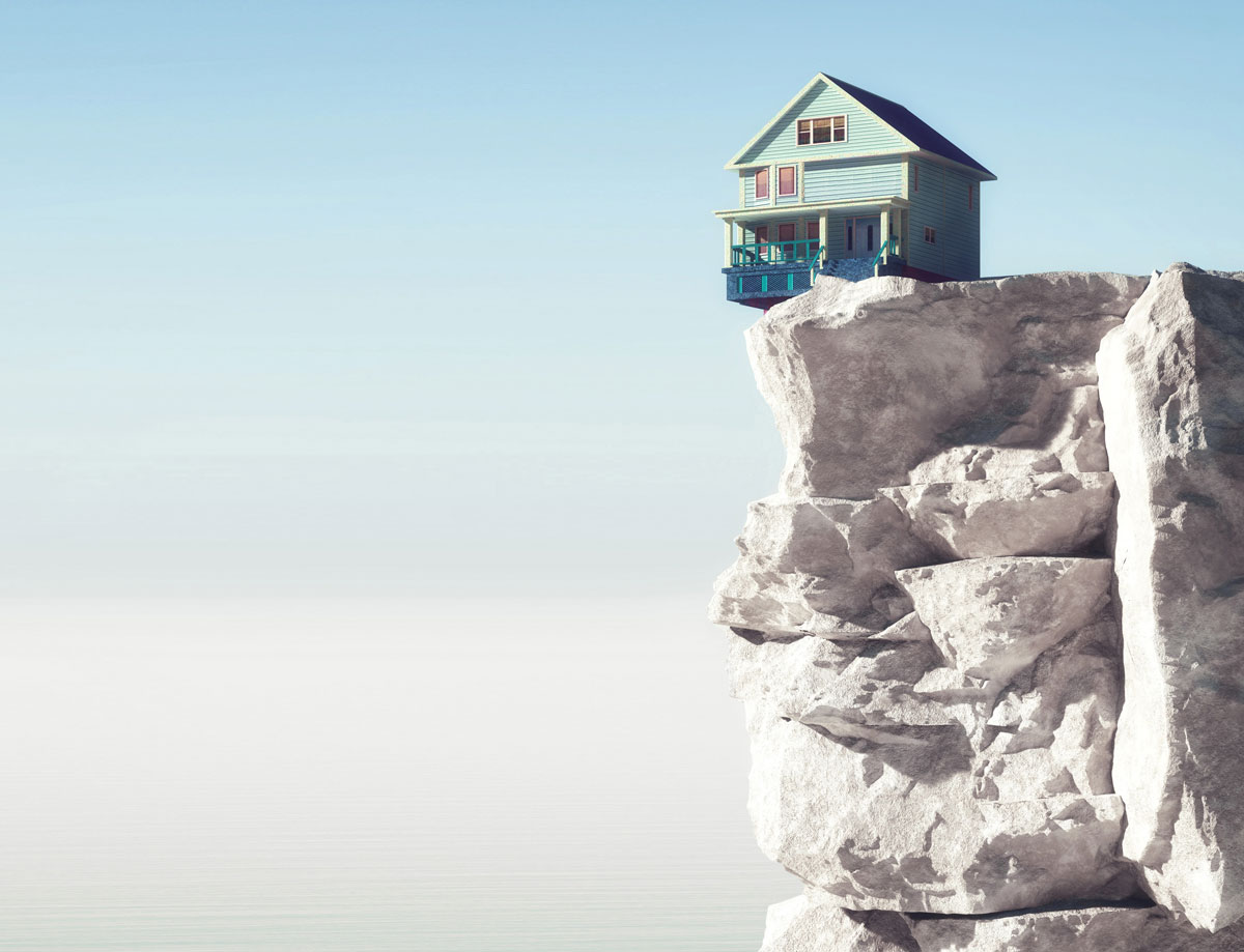 house on top of a beach cliff