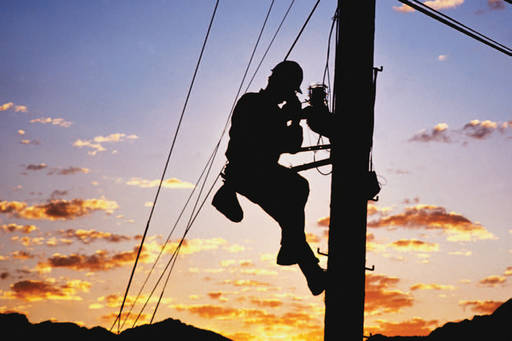 electric power worker repairing cable