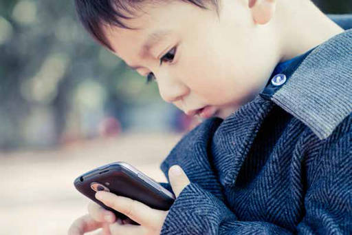 a kid holding a smartphone