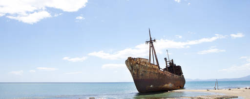 rusting ship at shore