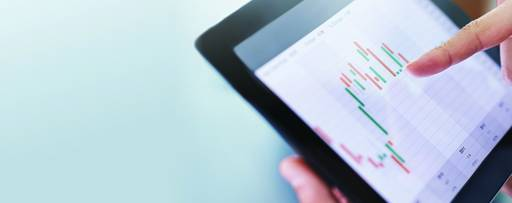 analysing investment charts with laptop