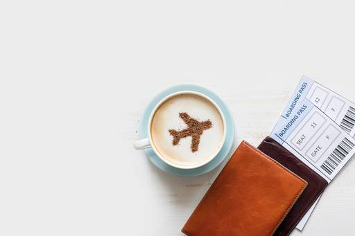 coffee, plane and boarding pass