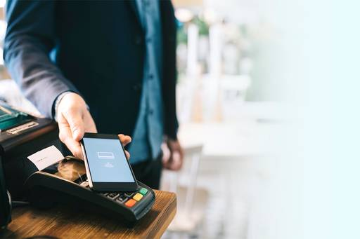 A man paying with smartphone using NFC