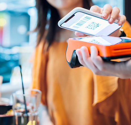 paying with smartphone in cafe