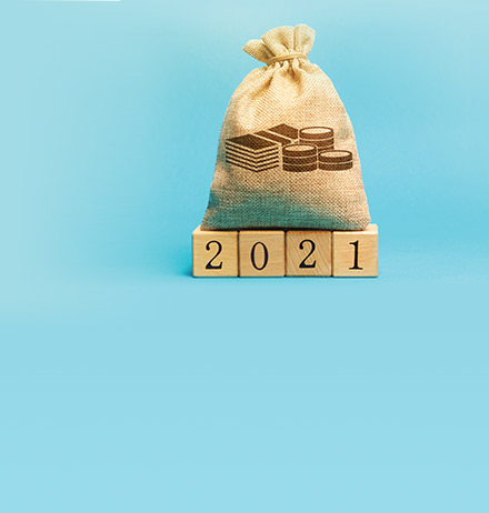 money bag and wooden blocks 2021