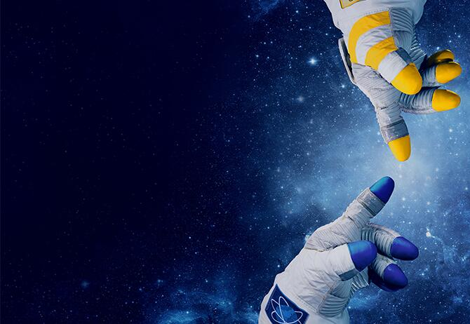 Two astronaut hands almost touch each other