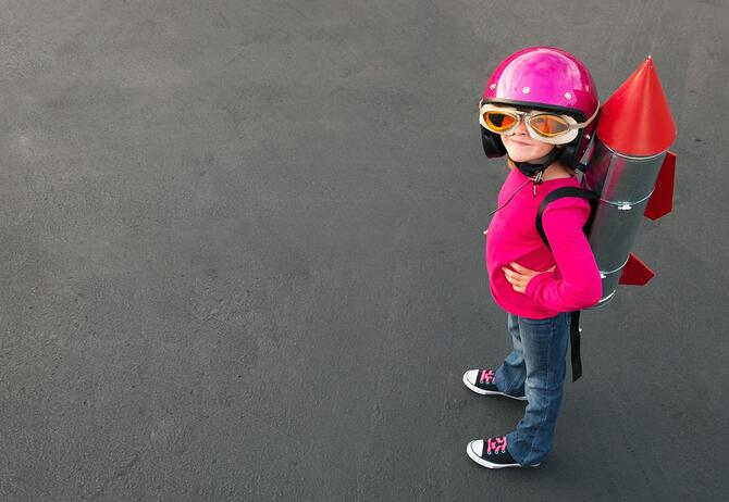Child with spaceship backpack