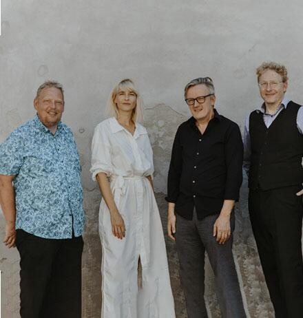 Marie Høst with three panelists