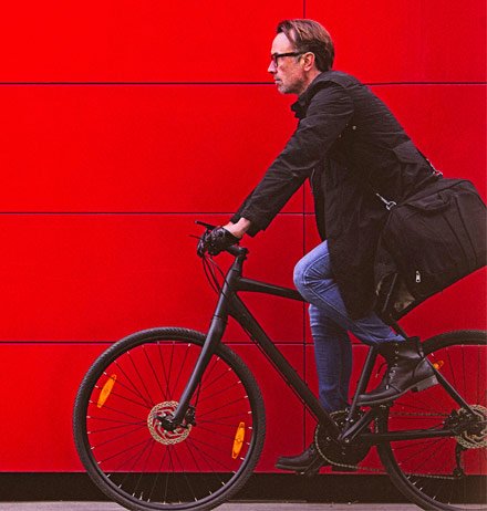 man on bicycle, red background