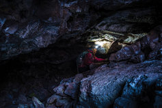 Woman with torch caving