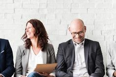 Group of employees laughing
