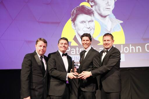 Don O'Leary accepts the Business Person of the Year award on behalf of Patrick and John Collison of Stripe from KPMG's Seamus Hand (right), Minister for Finance and Public Expenditure and Reform, Paschal Donohoe TD, and The Irish Times Business Editor, Ciarán Hancock.