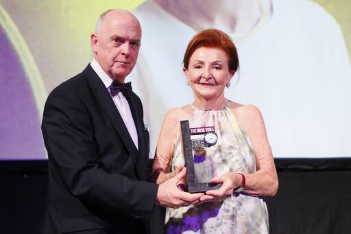 Breege O'Donoghue of Primark receives the Top 1000 Distinguished Leader in Business award from The Irish Times Managing Director, Liam Kavanagh.