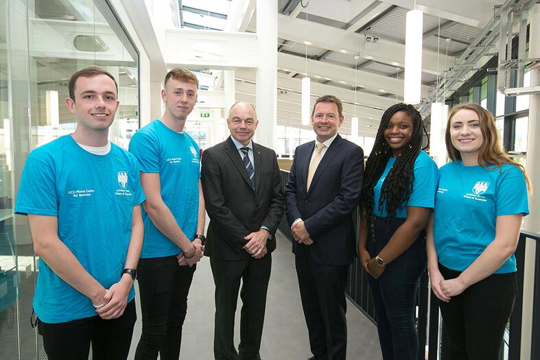 KPMG Managing Partner Seamus Hand and UCD President Professor Andrew Deeks pictured with students at the launch of the KPMG Skills Zone at the opening of the new Moore Wing at the UCD Quinn School of Business.