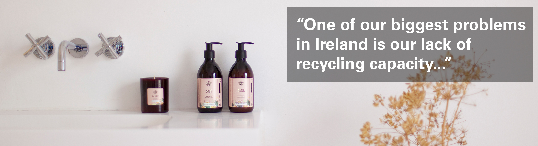 """Photo of The Handmade Soap Company's products in a bathroom with the text """"One of our biggest problems in Ireland is our lack of recycling capacity"""" overlaid."""