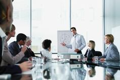 Man addressing a meeting in boardroom