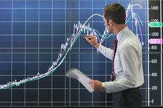 Businessman charting a line graph