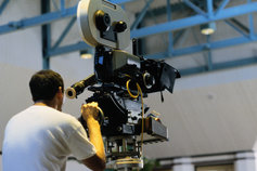 cameraman operating a movie camera