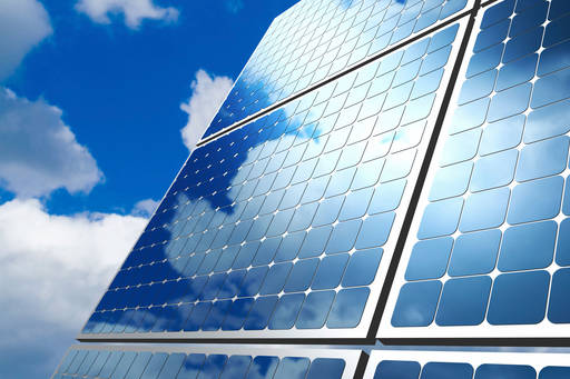 Solar panels with sky in background