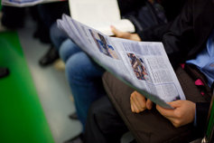 reading daily newspaper
