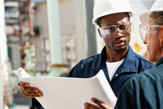 industrial-workers-reviewing-plans