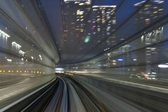London railway line blurred and moving at high speed