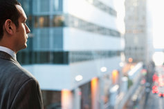 businessman looking at city scene
